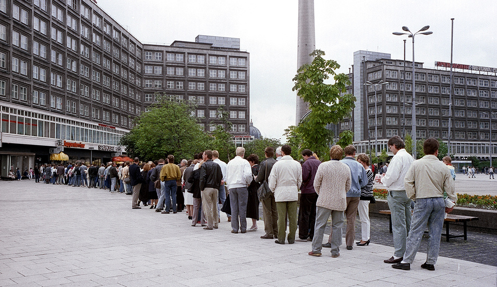 People lining up to open a new bank account - Late June or early July East Berlin.