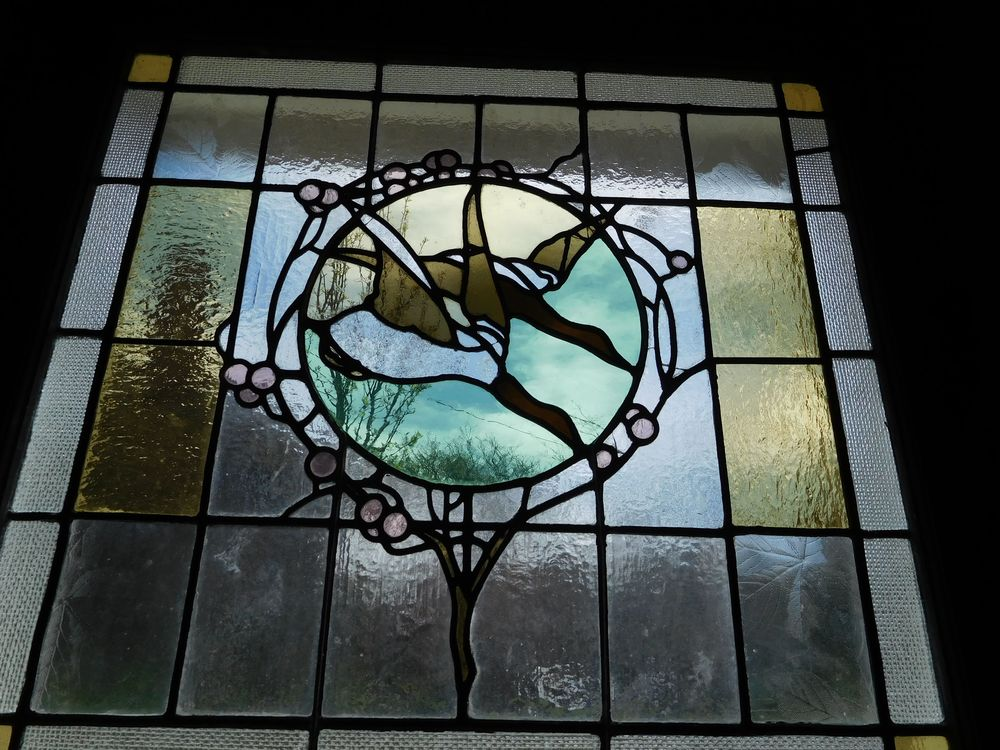 West Mansion billiards room stained glass ducks.jpg