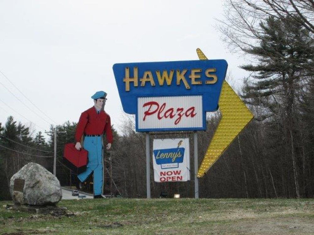The recently restored Hawkes Plaza sign is more commonly known as the Walking Man Sign, although his legs don't actually move, just his arms.