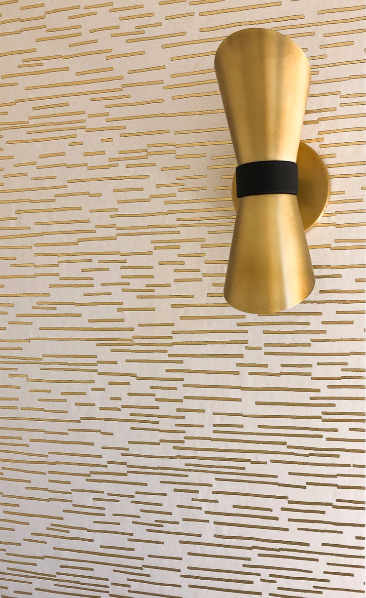 Metallic gold wallpaper from    Home Remedies    pairs perfectly with the modern light fixtures