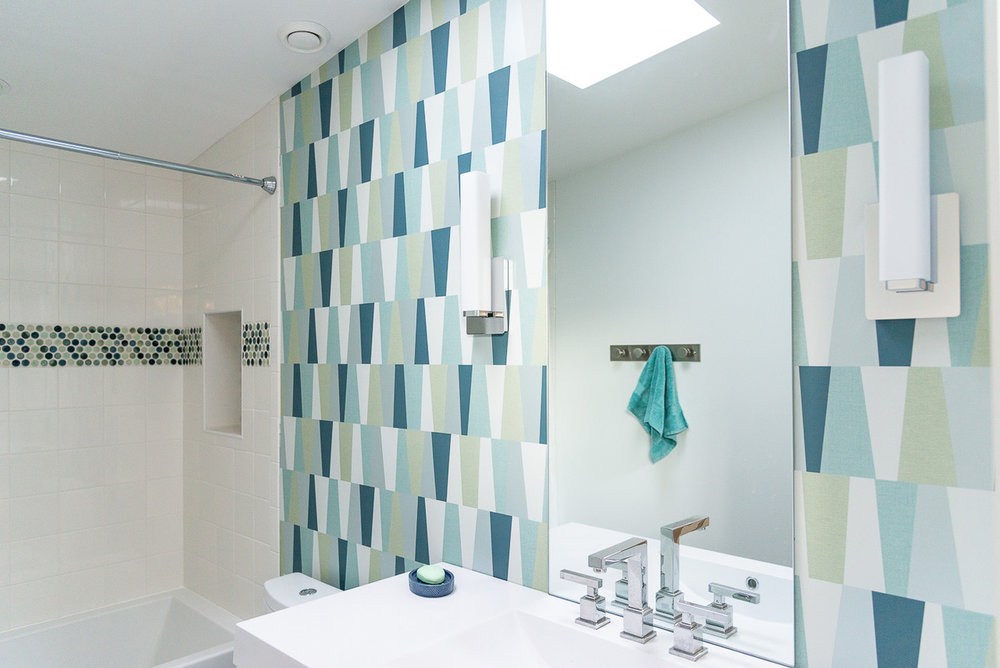 Modern wallpaper from    Maine Paint    stands out in the family bathroom