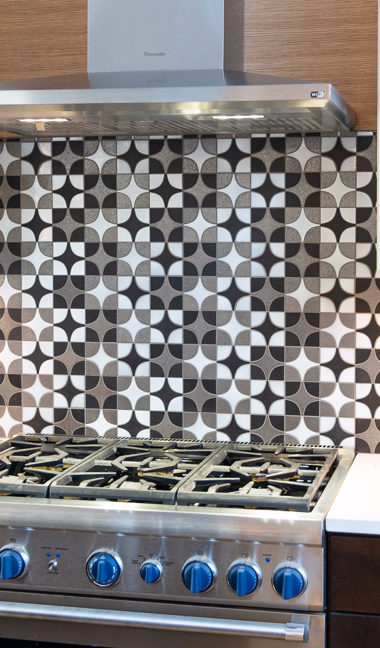 Stardust tile from       Old Port Specialty Tile Co.       on display above the stove