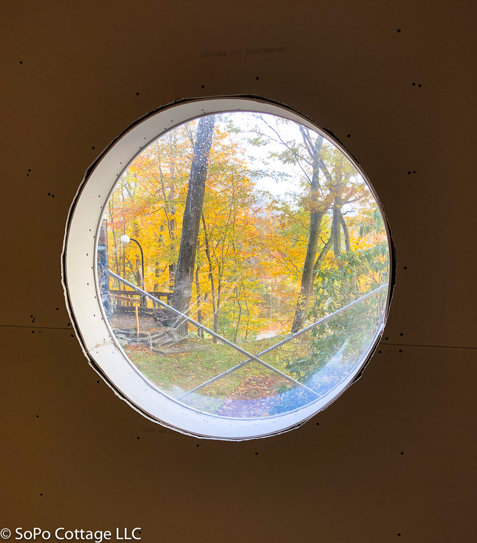 Laurel worked with    Maine Preservation    to identify key historic features of the home, like this original bubble window in one of the bedrooms