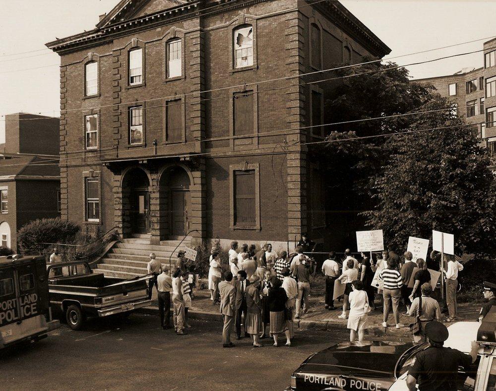 Landmarks volunteers protest the loss of 76-78 Park Street.