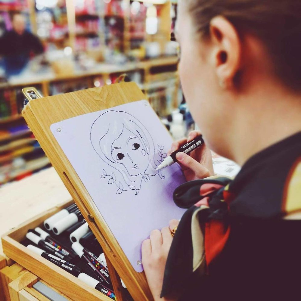 Chloe drawing a super cute portrait
