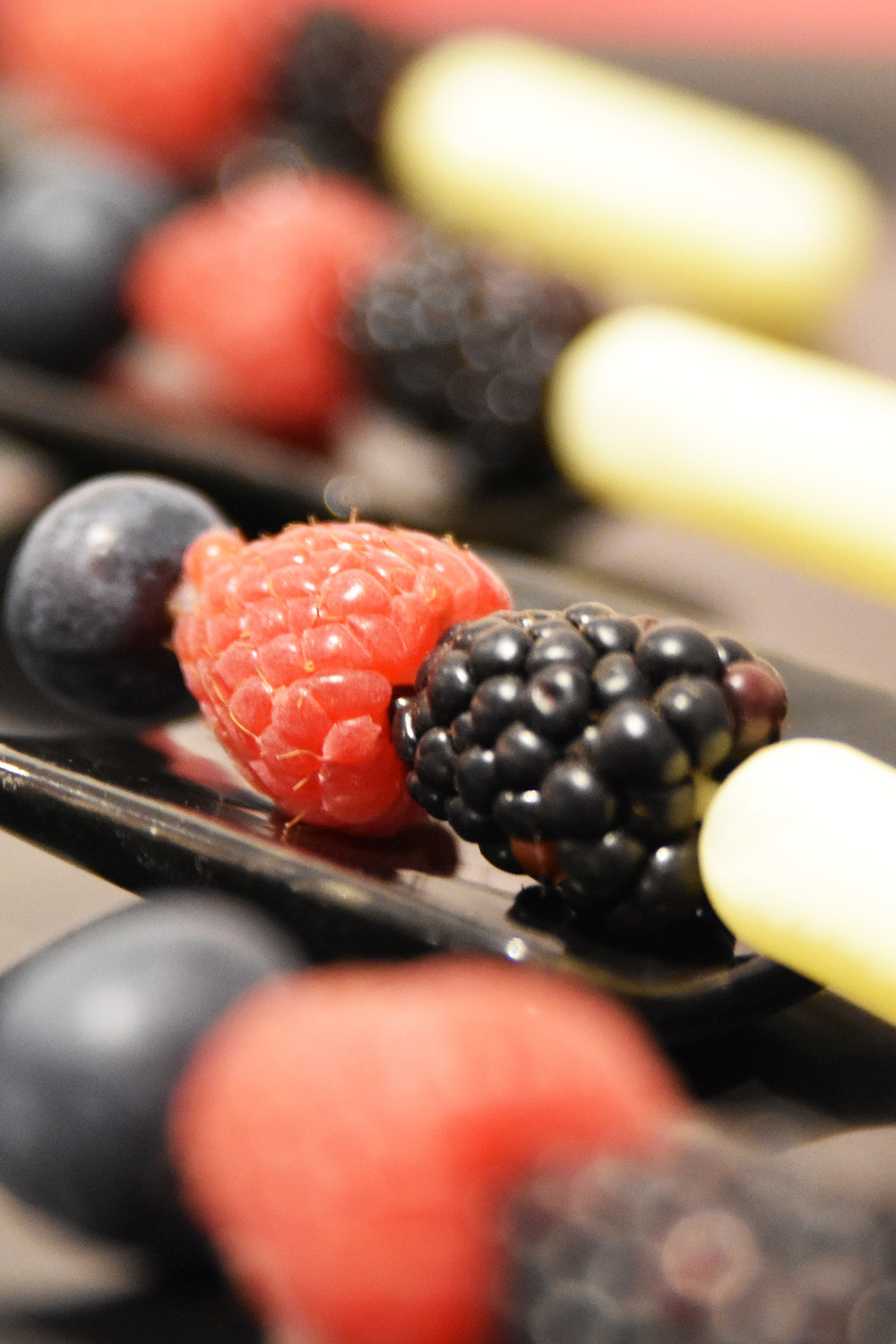 Lemon curd pipettes with fresh berries