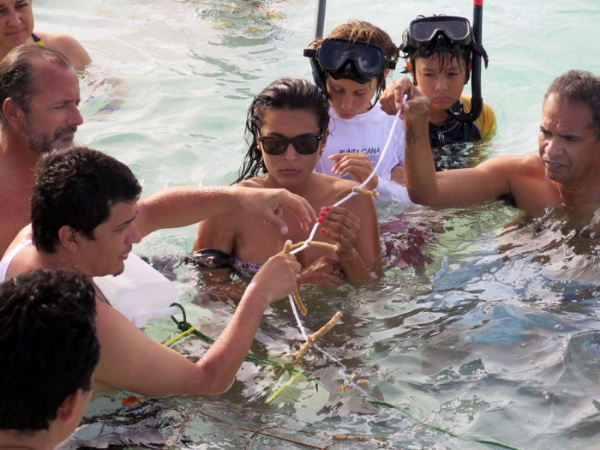 Coral farming provides a means for communities, volunteers, and students to learn about reef health and restore degraded sites. Photo credit Pedrito Guzman