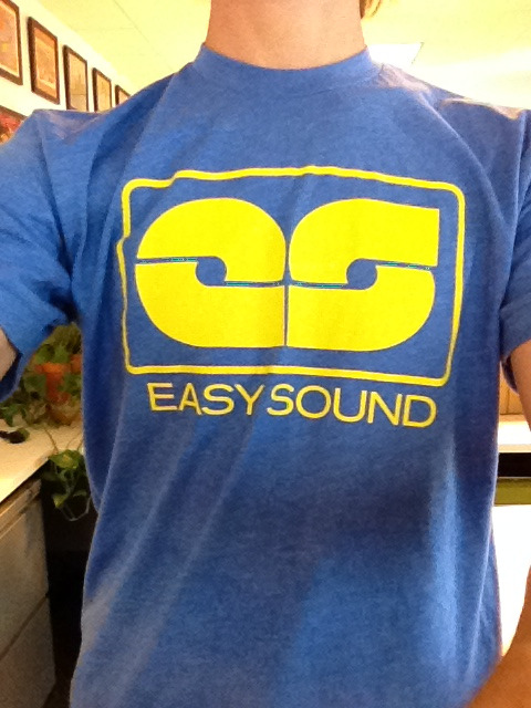 The T-shirt, by EASY SOUND.   In heather lake blue, heather black, and athletic grey.