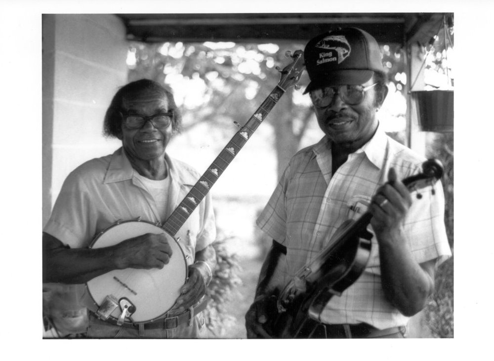 Joe Thompson (fiddler and dance caller, 1918-2012) with Odell Thompson (banjo, 1911-1994) in 1988 (photo: Nancy Kalow)