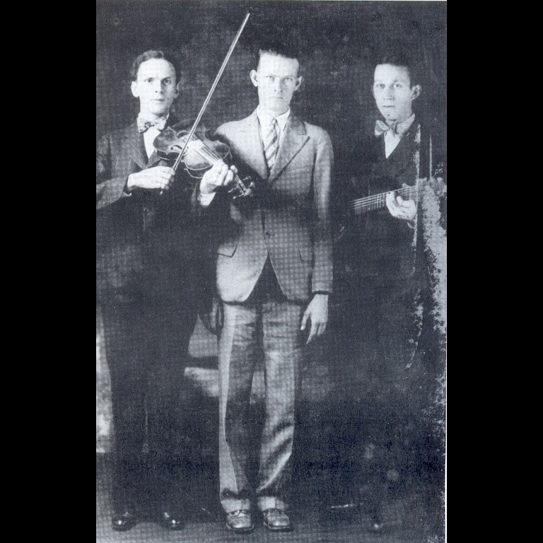 Dance caller, Ernest Legg (center) with the Kessinger Brothers (Charleston, WV, 1928)