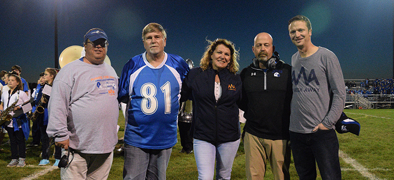 John Manion (L-S Head Varsity Football Coach), Keith Walker, Lynn Walker (Caleb Walker's parents), Dave Gingrich (Cocalico's Head Varsity Football Coach), and Joe Fittipaldi (President, A Week Away). Photo courtesy of  the Lampeter-Strasburg School District  website .