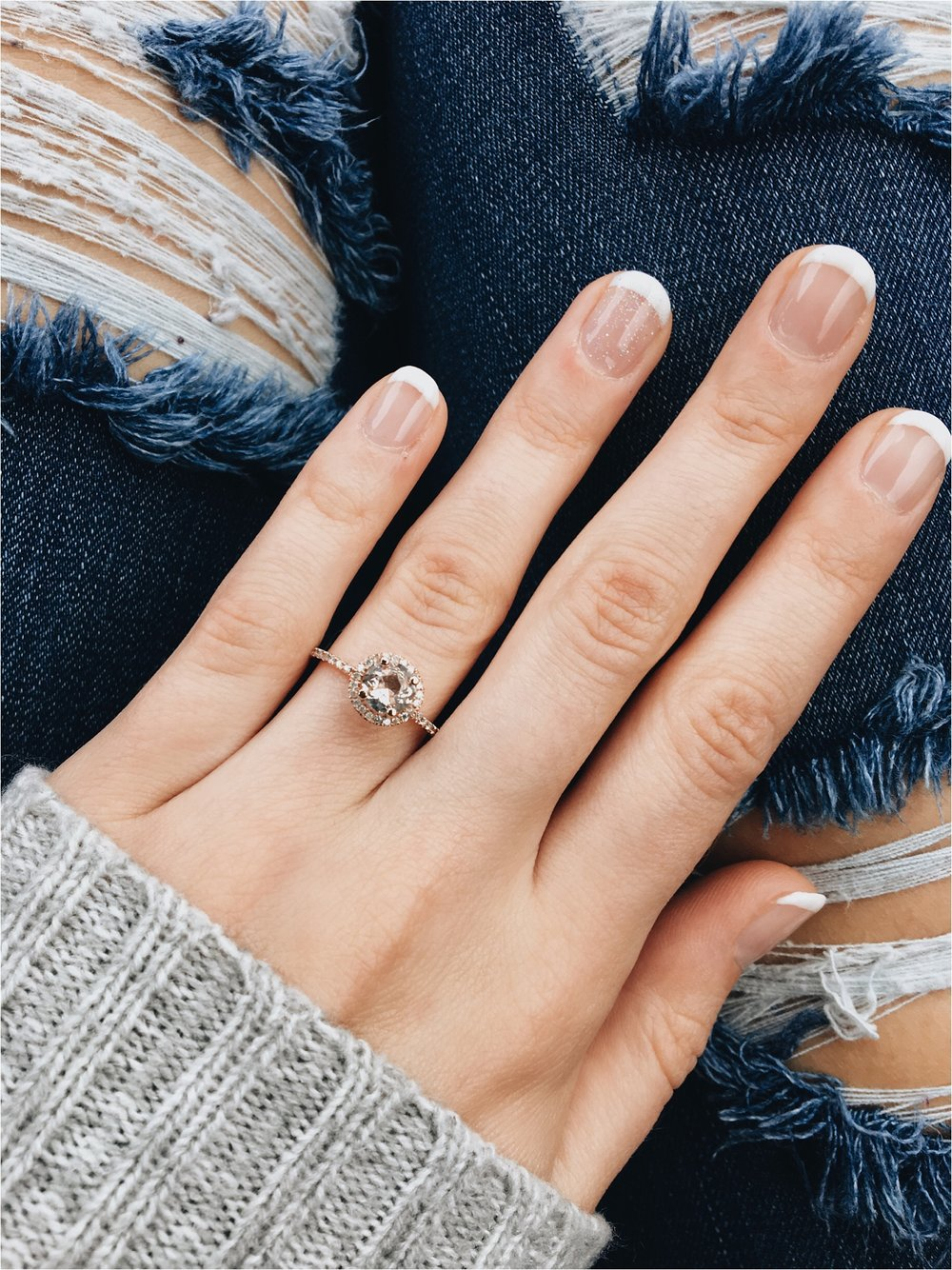 Didn't he pick the most beautiful ring? <3 The center stone is morganite and it's surrounded by tiny diamonds. I also really love the rose gold!