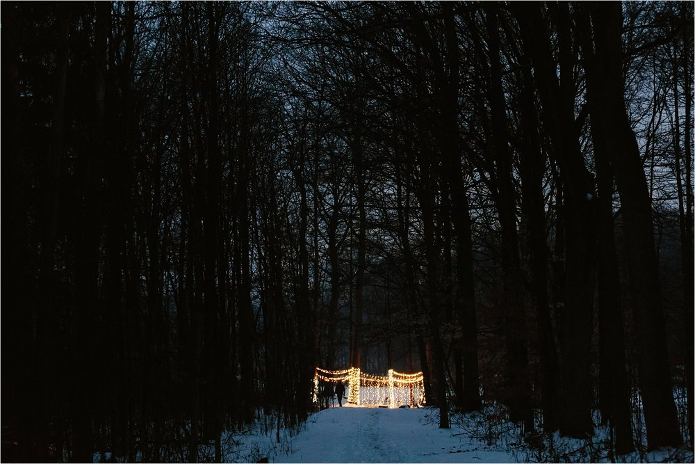 The night of the proposal (about a half hour before Caiti arrived). Isn't it cool how tucked away in the woods it was? Right behind the lights there's a huge lake too!