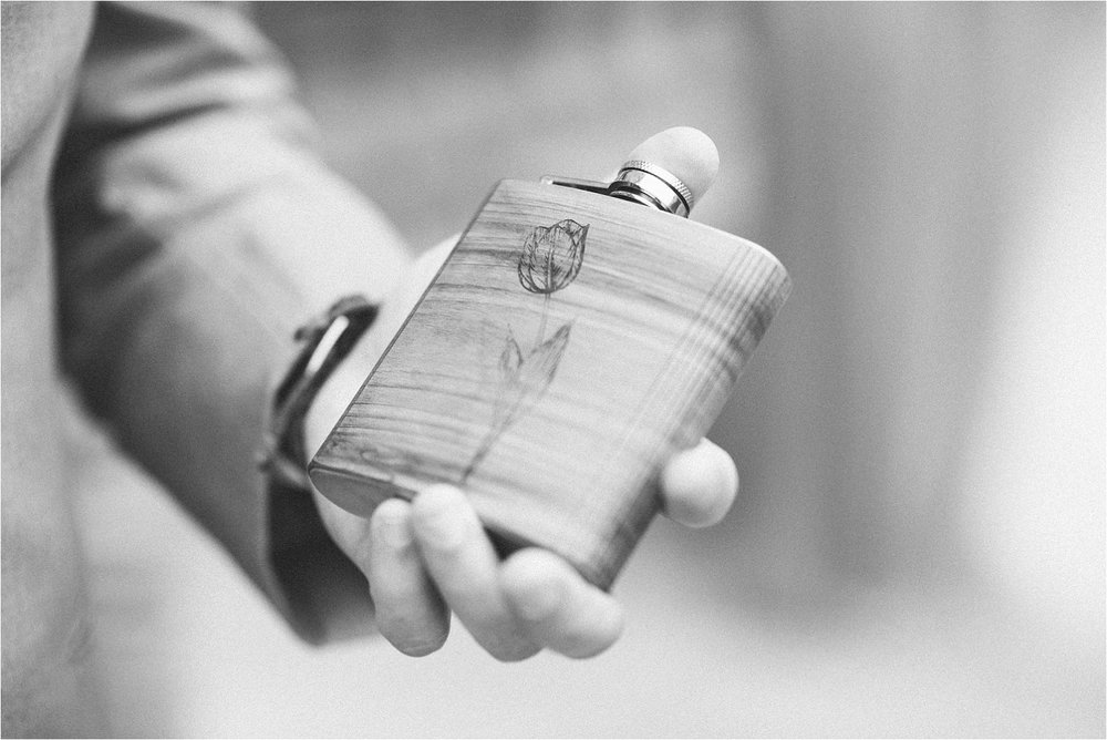 One of my favorite details of the year is this custom flask. Great find!