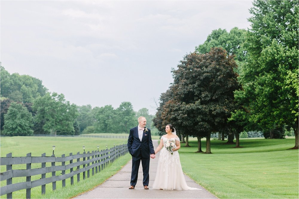 Brookside Farms  in Louisville, Ohio. It rained all day on their big day but it wasn't any less perfect!