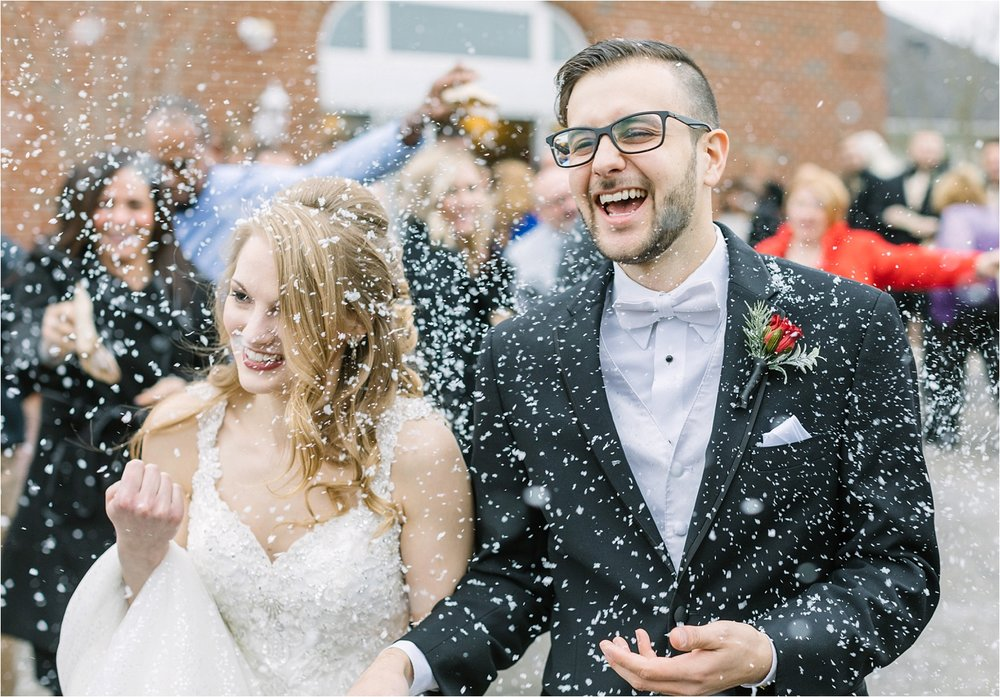 This was our last wedding of 2018! Donny & I photographed this just last weekend, so while we don't have a full gallery of edited images to choose from yet, I included some of the sneak peeks we just recently shared.  The fake snow was a hit!