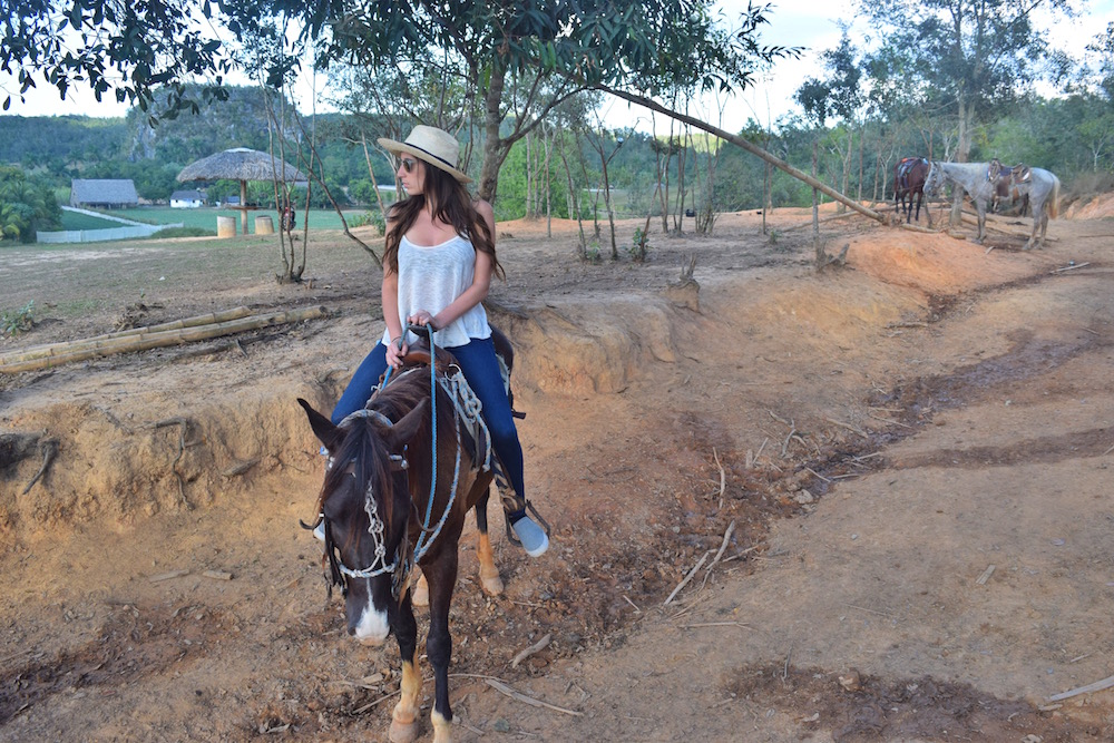One of the best ways to see the sights is on horseback while in Vinales - very easy to do - click through to find out how - - Tessa Juliette | http://travelwheretonext.com/cuba