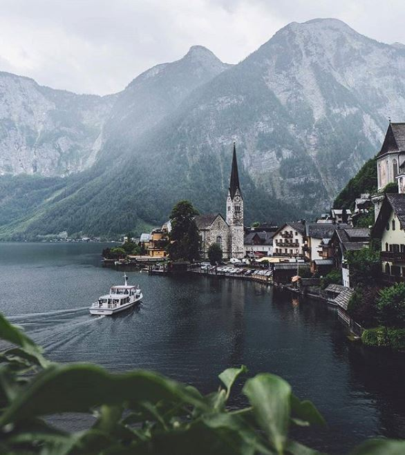 Hallstatt  The entire city is just plain gorgeous. Hiking to the top of the mountain or simply the iconic view of the lake, cathedral, and mountains -