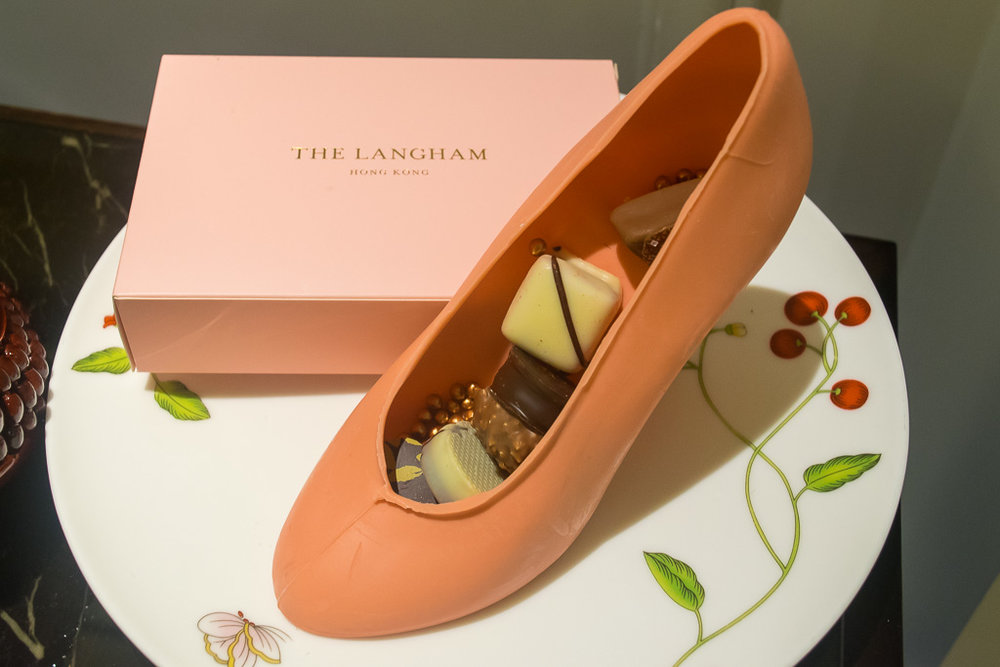 Cute welcome gift from The Langham in Hong Kong -The shoe is made of chocolate and in their signature Langham pink