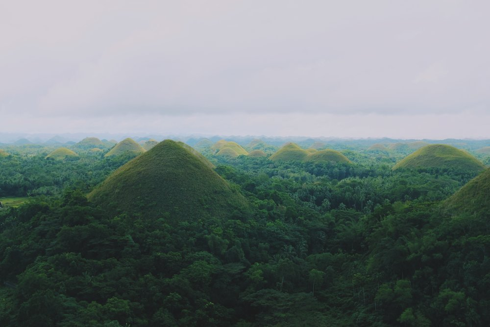 Chocolate Hills in Bohol are a must see in the Philippines. Souce:   Jacky Lo     on   Unsplash