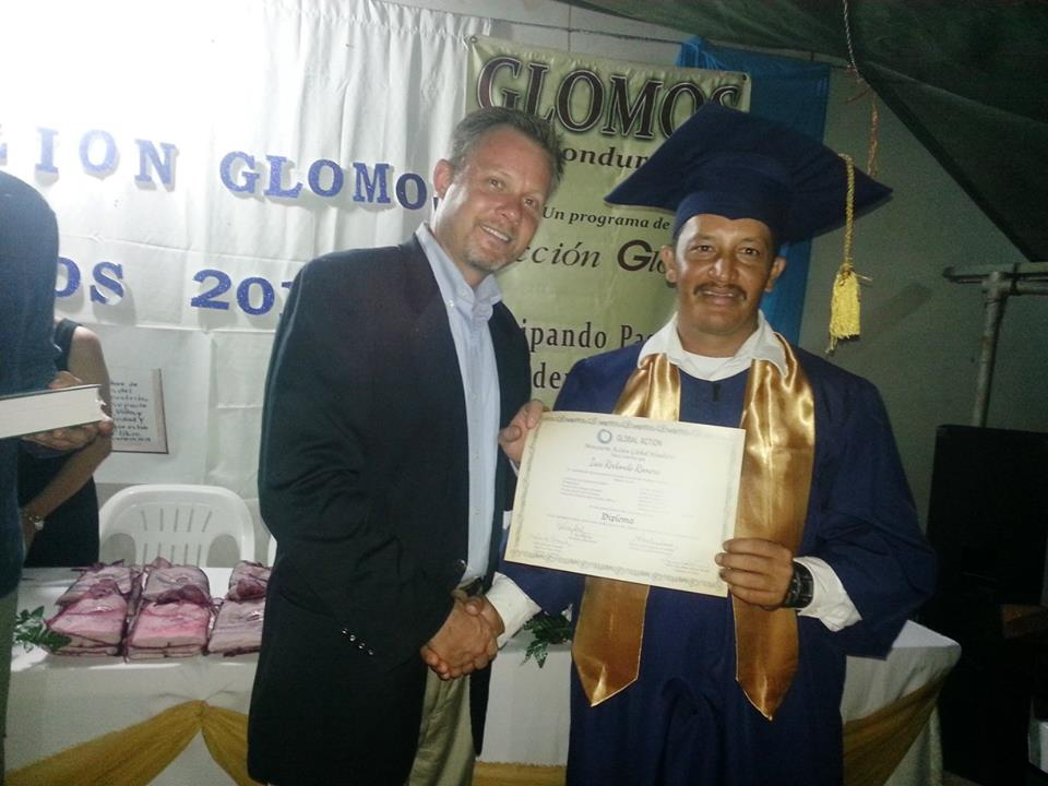 Graduation palacios Phil presenting certificate.jpg