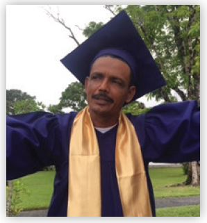 Pastor Marvin celebrates his graduation.