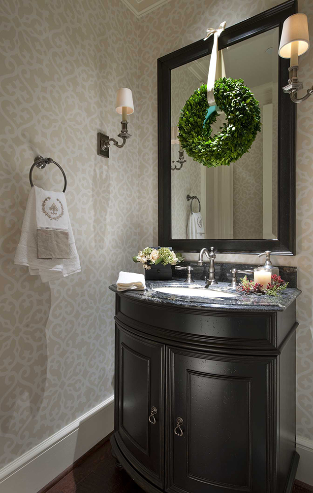 A subtle, tone-on-tone pattern in this Highland Park, Dallas powder room keeps the wallpaper from overwhelming the small space.