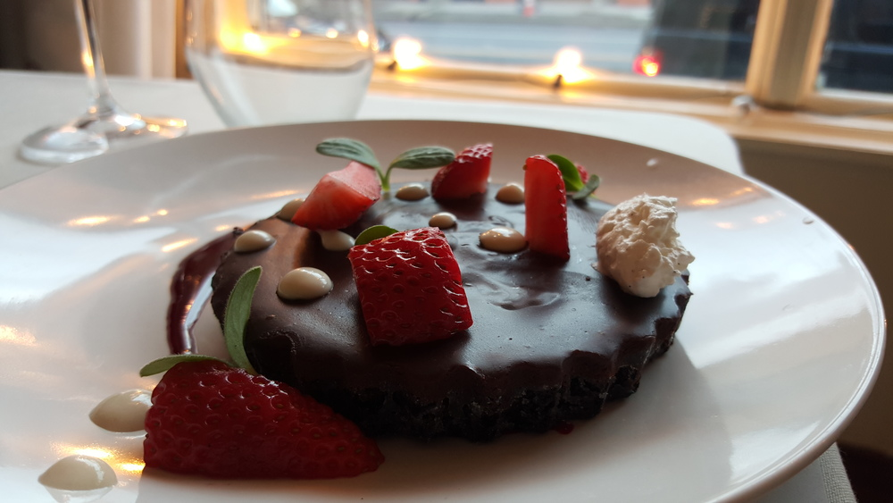 Chocolate tart, fresh strawberries, hazelnut crema