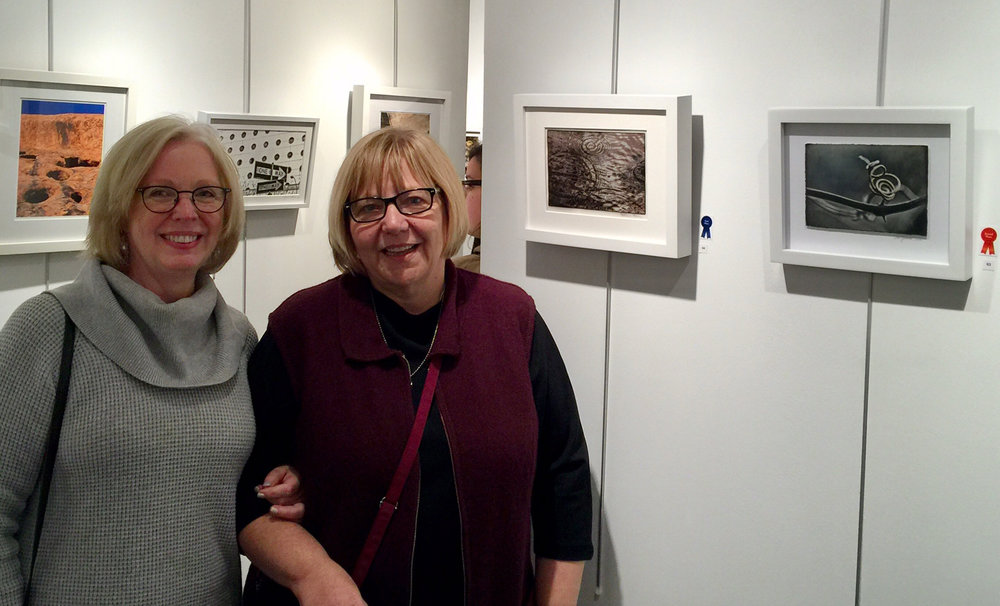 Award winners Patricia Beary and Lois Youmans with their works