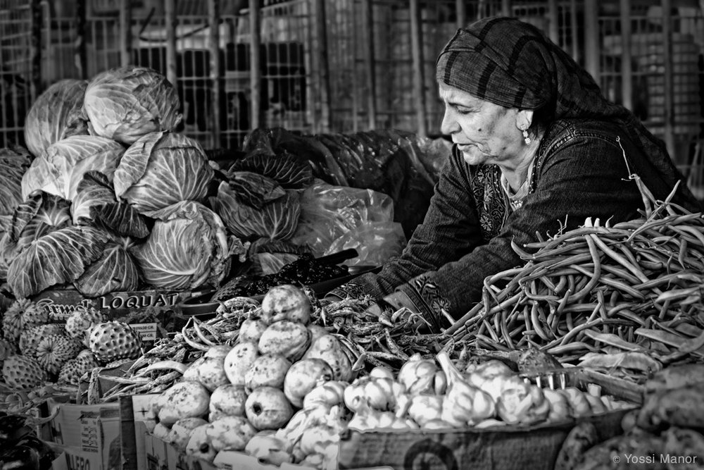 Vendor at the Market by Yossi Manor