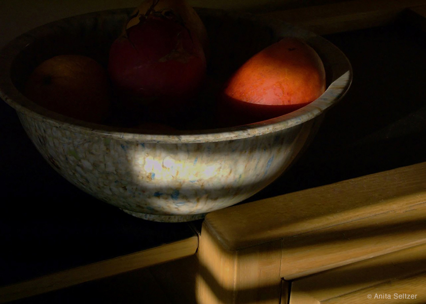 Bowl and Ripening Mango Bathed in Slatted Sunlight by Anita Seltzer