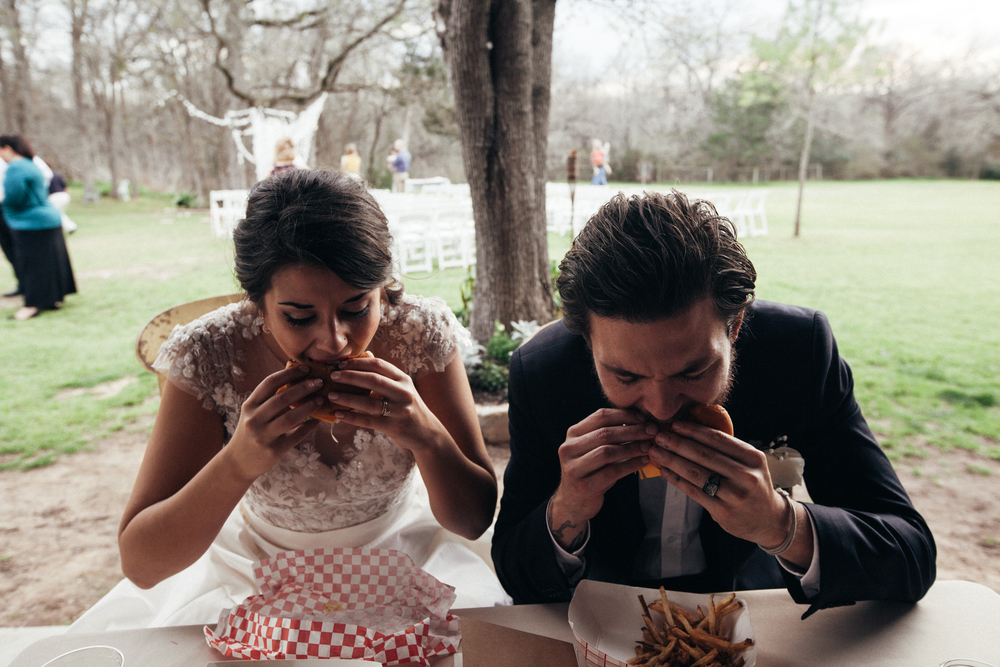 "People always say, ""You never eat at your own wedding!"" to which I say, ""YOU HAVEN'T MET ME."" Matty and I are huge fans of local burger joint, P. Terry's, and we were delighted to find that their food truck fit nicely in our budget. While we were taking photos after the ceremony I noticed that the truck hadn't arrived yet and I started asking questions...  Apparently the fiasco behind the scenes was that the truck broke down on the way to the venue. I'm pretty sure everyone was trying to keep me occupied but my stomach was growling and the guests were mingling and...suddenly I was aware that dinner had not arrived.  Not long after, the truck pulled up behind a tow and our guests all cheered! I loved it. We immediately stuffed our faces and even had some time to relax while everyone went to get their food. It was pretty great and I ate every single fry because it's my wedding and I'm eating.  We had several people thank us for that meal :)"