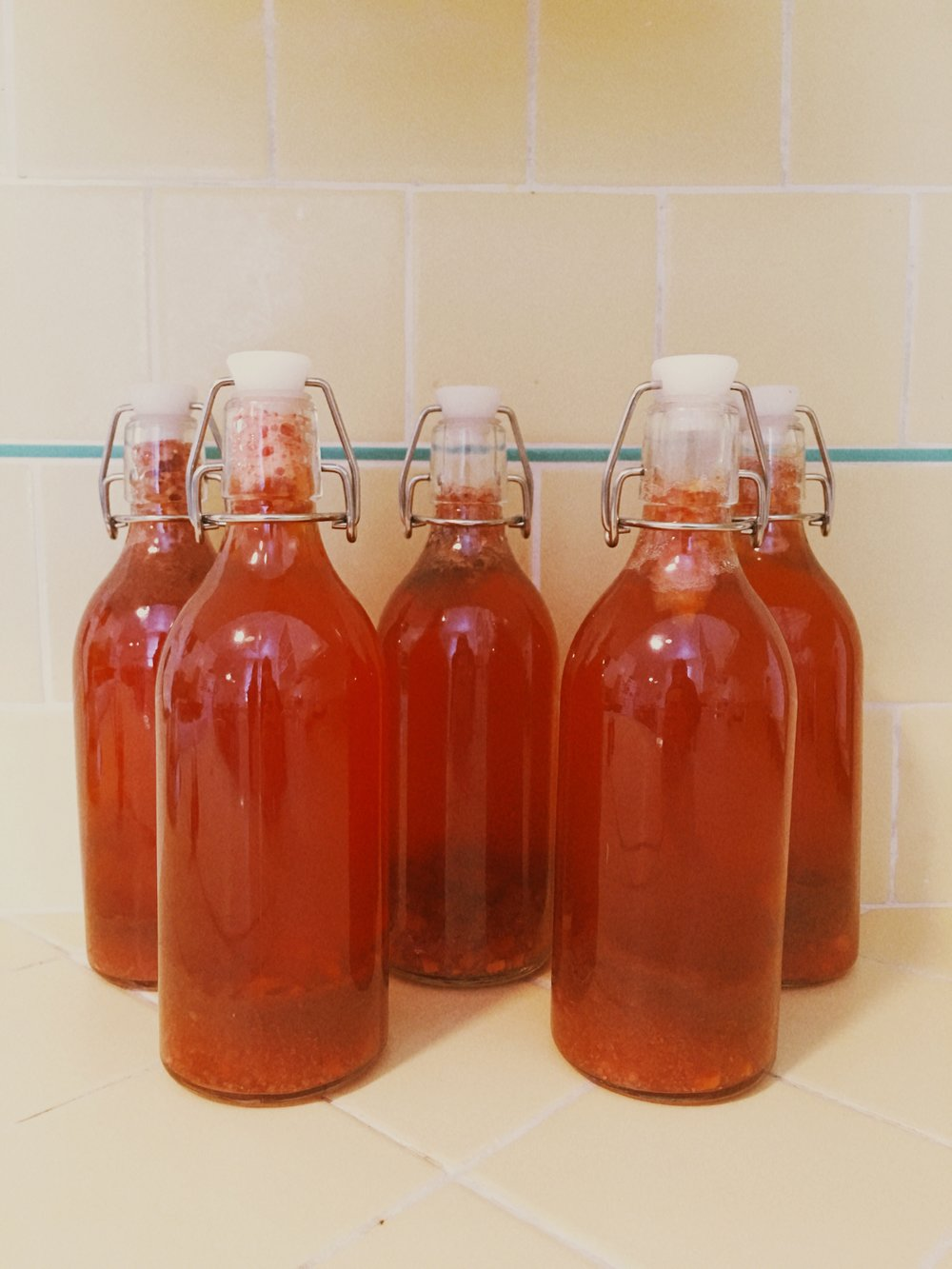 My current brew: strawberry puree with a squeeze of lime and a teaspoon of ginger per bottle.