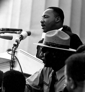 Dr. King delivers his historic speech.  Photo Credit: Wiki Commons (Public Domain).