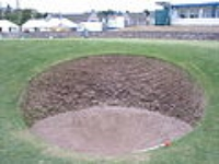 Pray for strength all who enter.  The Road Hole Bunker on 17 at St. Andrews.  Photo Credit Wiki Media Commons (Public Domain by Alan Stewart).