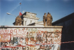 The Berlin Wall right before the ultimate triumph of Air Force accounting procedures. Photo Credit:  Yann via  Wikimedia Commons