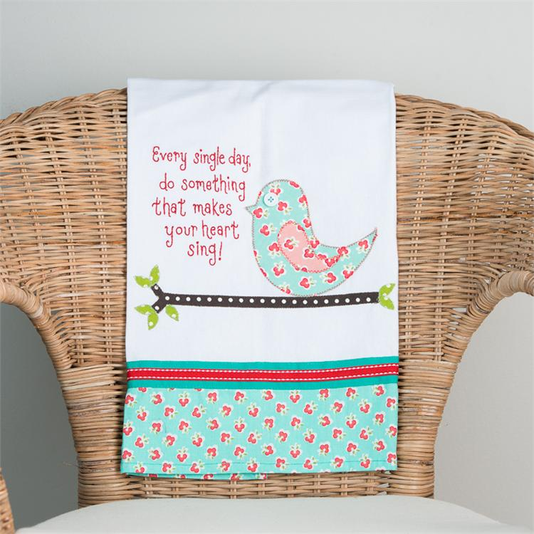 DO SOMETHING THAT MAKES YOU SING' TEA TOWEL  $16