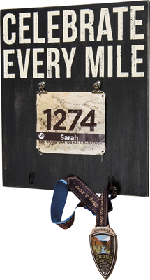 CELEBRATE EVERY MILE' BIB HOOK PLAQUE  $36