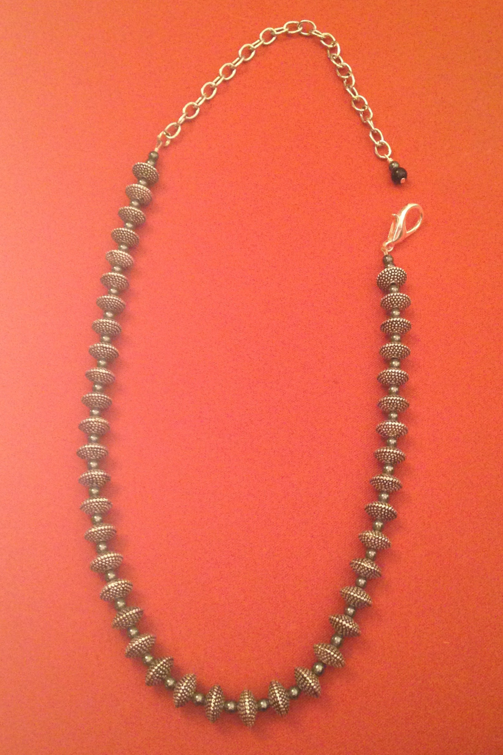 STEEL PEBBLE TEXTURE NECKLACE $120
