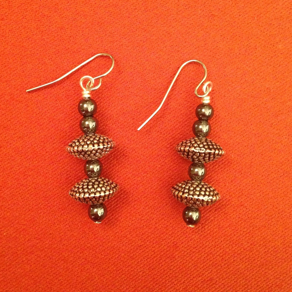 STEEL PEBBLE TEXTURE EARRINGS $58