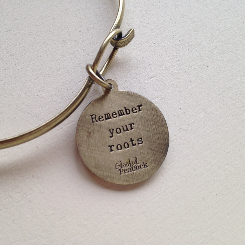 REMEMBER YOUR ROOTS TOKEN CHARM BRACELET $20