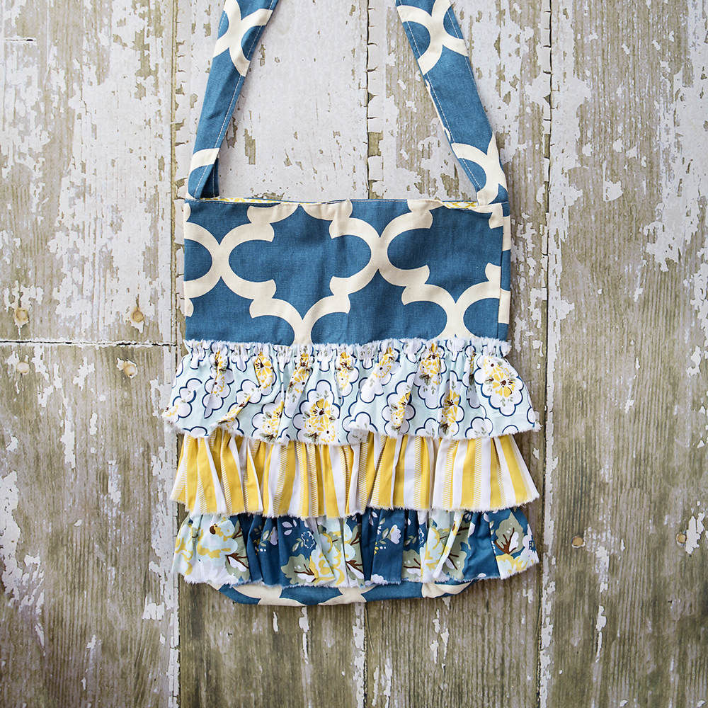BLUE ILLUSIVE RUFFLE BAG $56