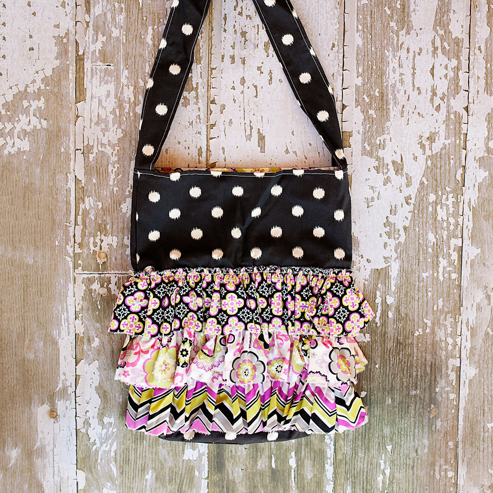 POLKADOT BLACK RUFFLE BAG  $56