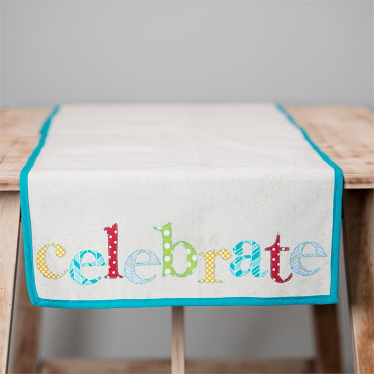 CELEBRATE' CANVAS TABLE RUNNER $48
