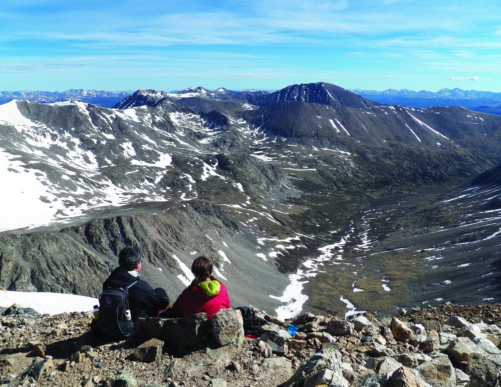 Climbers take in the view atop Mount Democrat in the Mosquito Range.