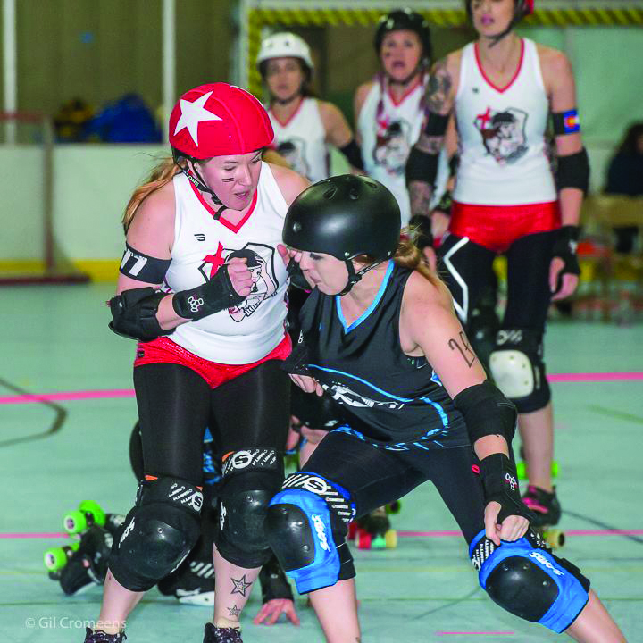 Photo: Gil Cromeens - At right, Amy Moore, better known as Dead Zeppelin, rocks an opponent during a bout.