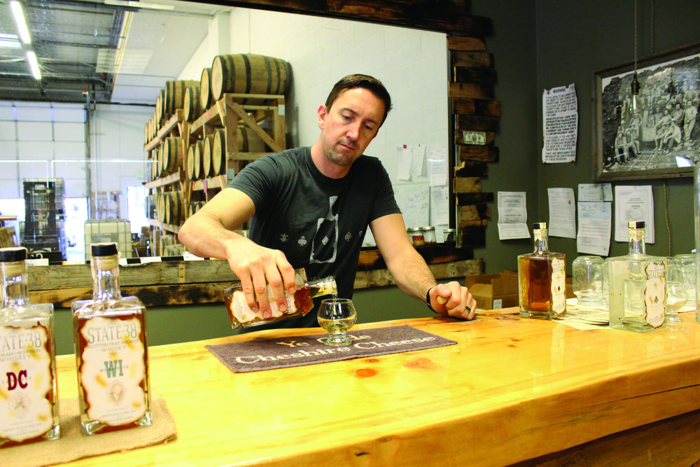 State 38 Distilling's Sean Smiley pours a drink of his Anejo Tequila.