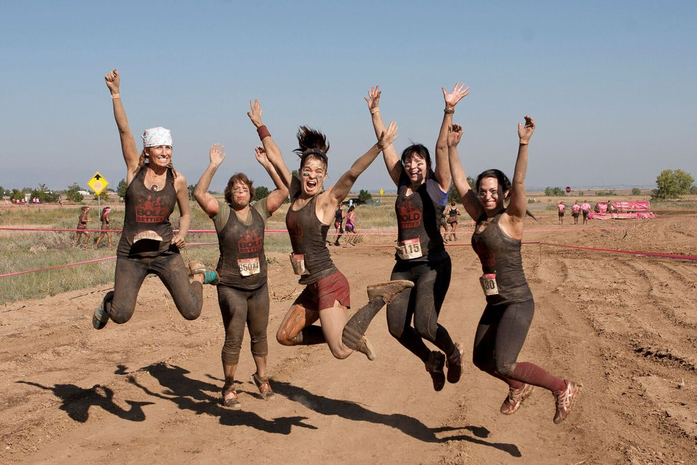 Bold Betties run, jump, hop, bounce and splash their way to the finish line at the Dirty Girl Mud Run in Denver, a premier women only running event supporting breast cancer awareness and research.