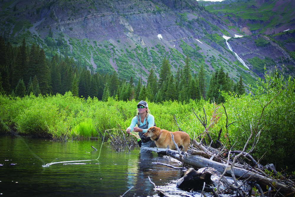 Sadie Olson and her pup Ella work a stream up Poverty gulch near Crested Butte.