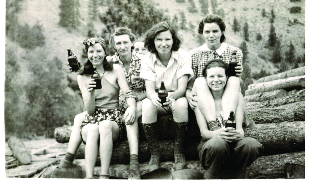 Ethel Cinnamon, inset, is holding a photo of herself, her four sisters and a cousin circa 1942 near Jamestown. In the larger image, she is bottom right with her sister's legs draped over her shoulder. Cinnamon said she wasn't sure if her dad brewed the beer they were drinking but he definitely distilled whiskey back in the day.
